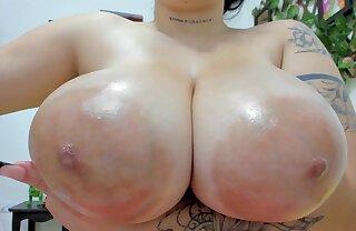 Kinky brown webcam slut surrounding oiled prevalent monster boobs - big nipples